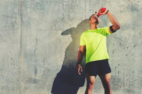 Athlete drinking a sports drink after a run