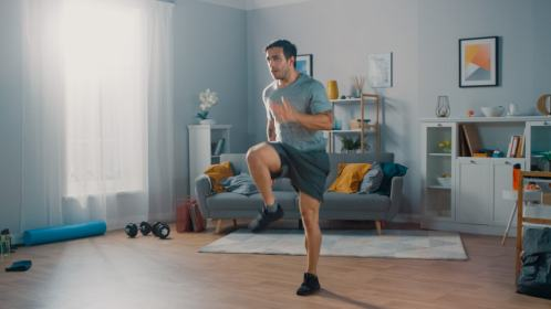 Man running in place at home for fitness