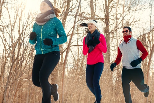 3 people walking in winter for fitness