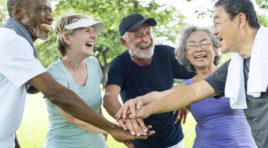 Group of seniors exercising together in a park