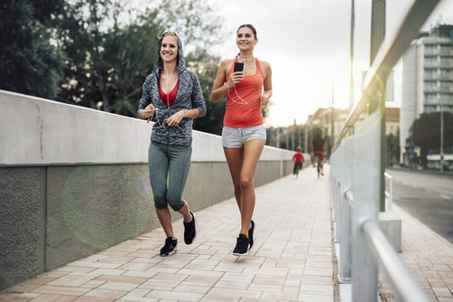 Women walking or jogging for fitness in city