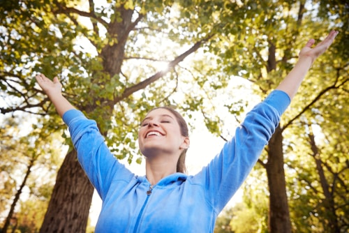 Woman celebrating in a sunny park