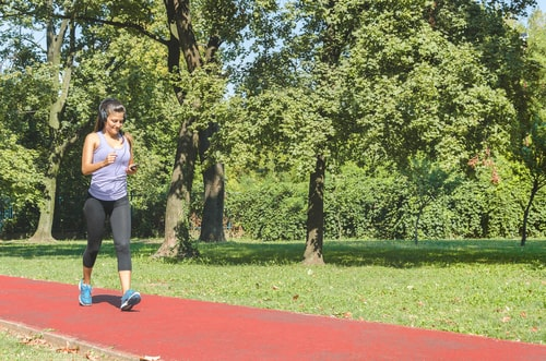 Woman fitness walking on a park walking track