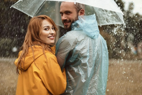 Couple with rain gear walking in rain