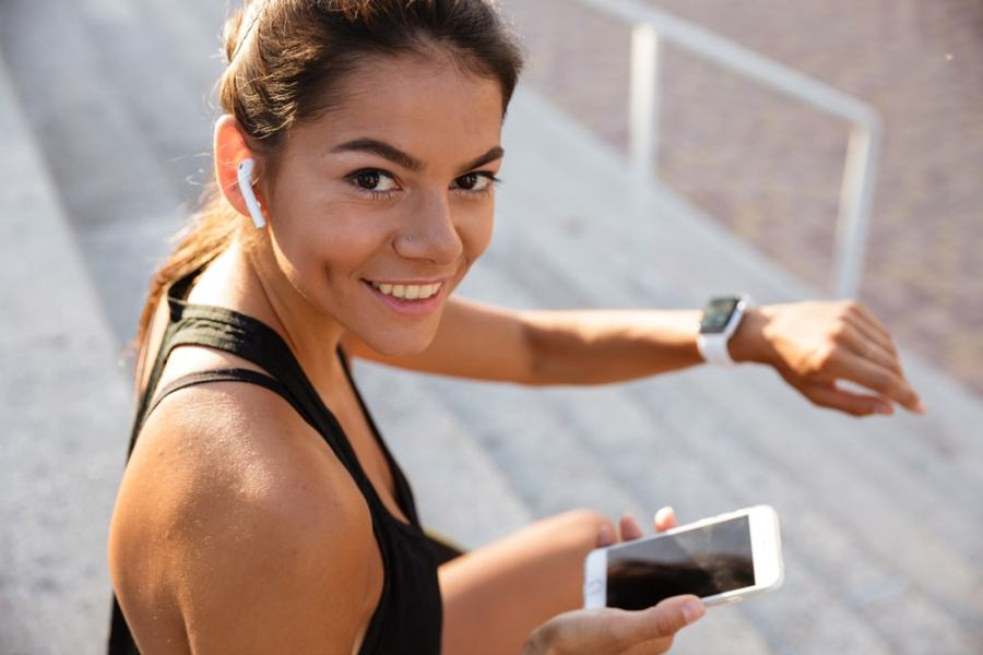 Athletic woman checking her phone during exercise