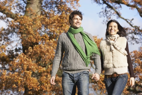 Couple walking in the park for fitness