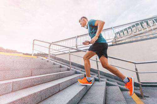 Man running up steps for fitness