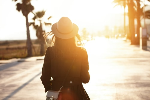 Silhouette of woman walking in morning
