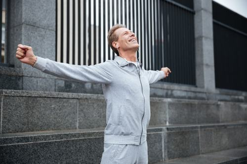 Man celebrating from hitting his exercise goals