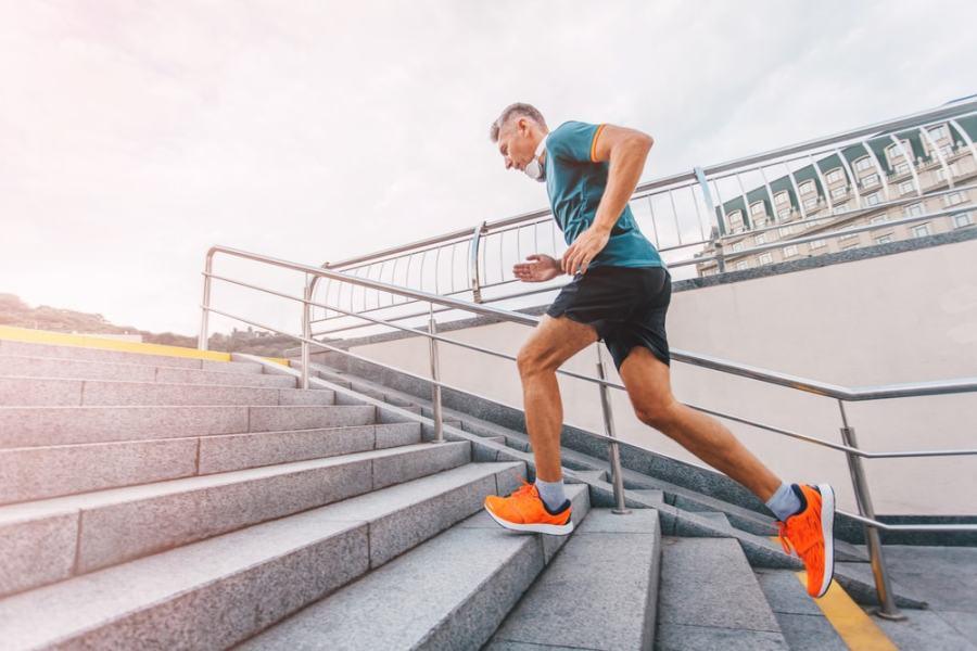Man walking up stairs for fitness