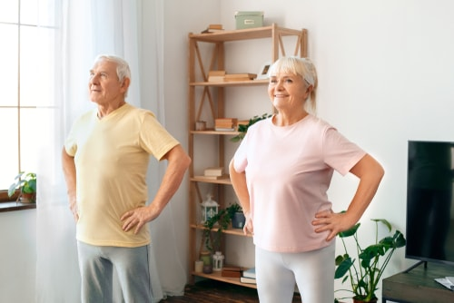 Senior couple doing dance exercise at home