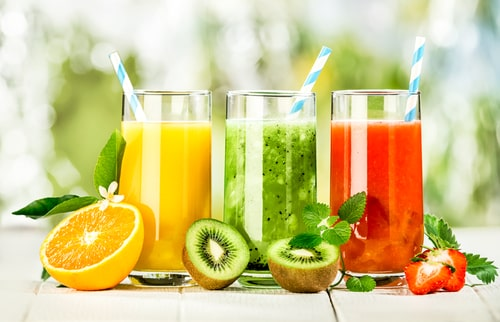 Colorful fruit and fruit juices in glasses