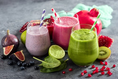 Colorful fruit smoothies and fruit