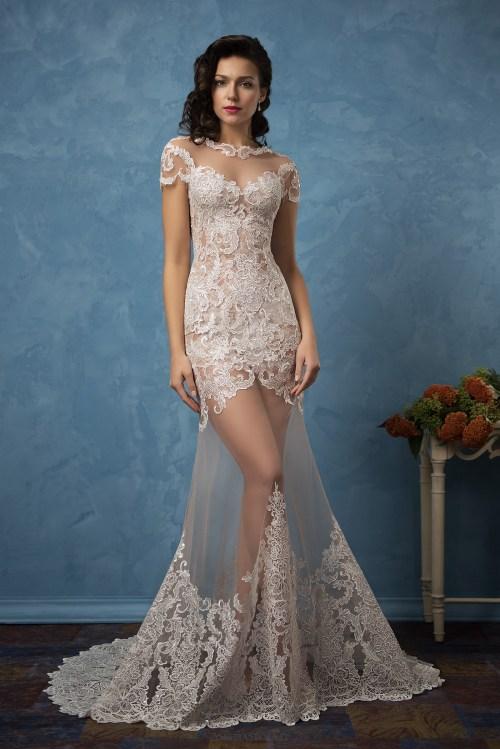 Robe de mariée effet transparence avec un jupe en voile délicatement teintée
