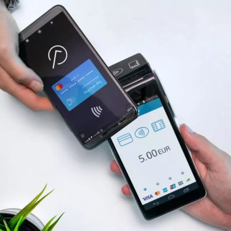 A phone paying on card reader with NFC