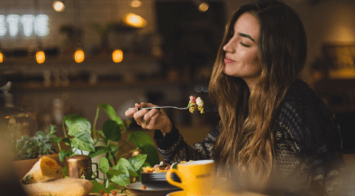 Women enjoying her meal and eating mindfully
