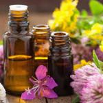 bottles essential oils and flowers
