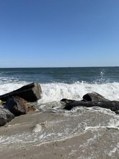 waves breaking on beach rocks