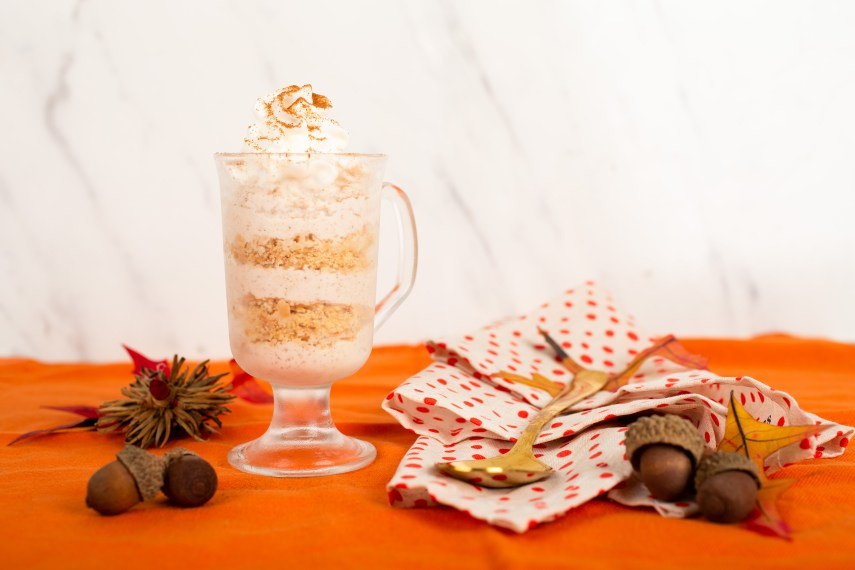 pumpkin mousse with whipped cream and cinnamon