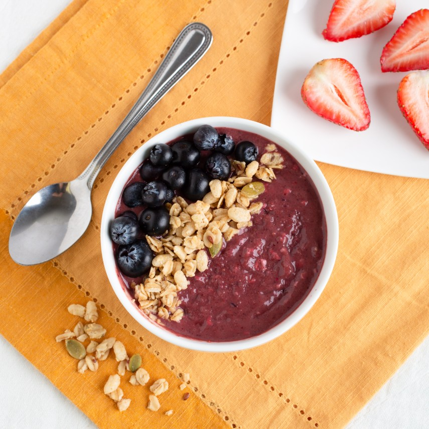 acai bowl with blueberries and granola