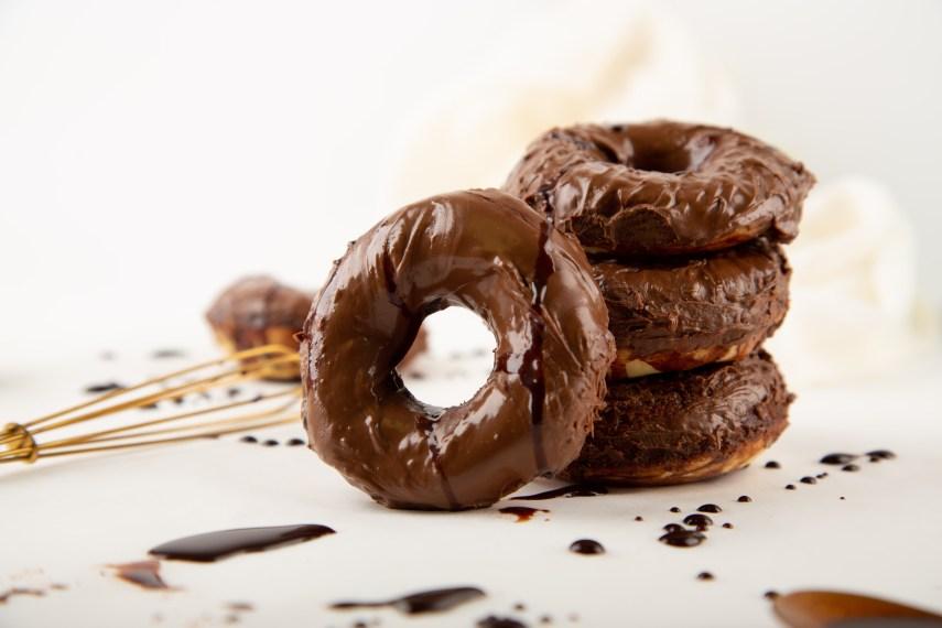 vegan chocolate kahlua donuts on parchment paper