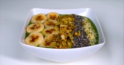 Our Green Fiber Smoothie Bowl topped with chopped bananas, homemade Matcha Granola, chia seeds, and hemp seeds.
