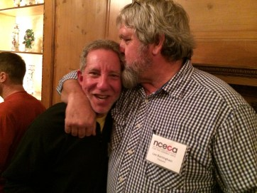 Boston area artist Steve Branfman gets a big kiss from NCECA Treasurer, Lee Burningham