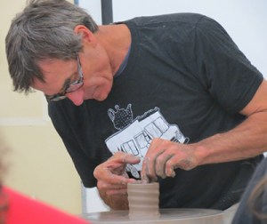 "​POW! collaborative Cup Project in action--Mark Shapiro demos at the ""Cup-latch"""