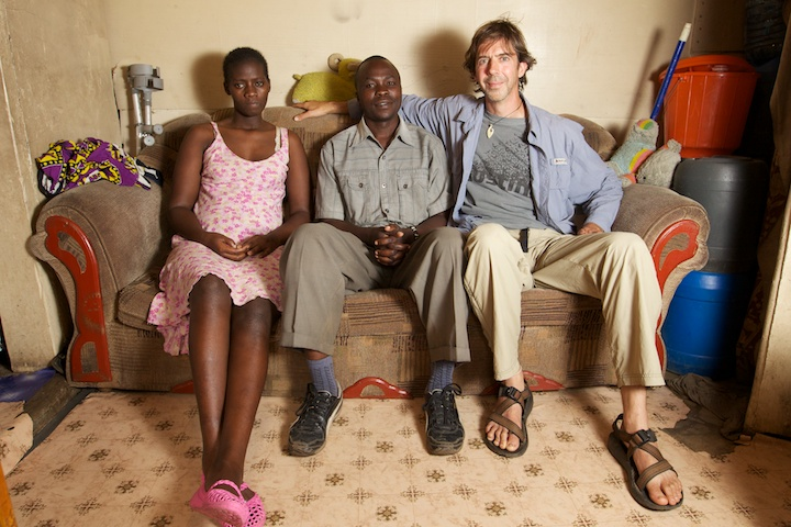 Nelson Guda with Ben and Janet in their home in Mathare