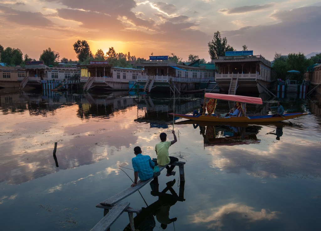 Two young boys fishing at sunset on Dal Lake in Kashmir. | Photo by Nelson Guda © 2019