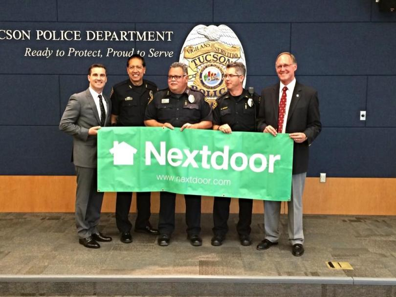 Jeremie celebrating a partnership announcement with the Tucson Police Department.
