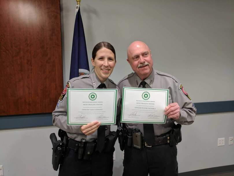Officer Tara Gerhard and Officer Wayne Twombly accept their awards from Nextdoor at the ceremony.