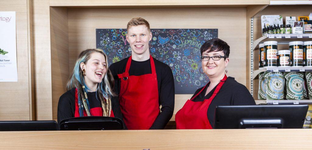 Nourish staff smiling inside a Nourish store