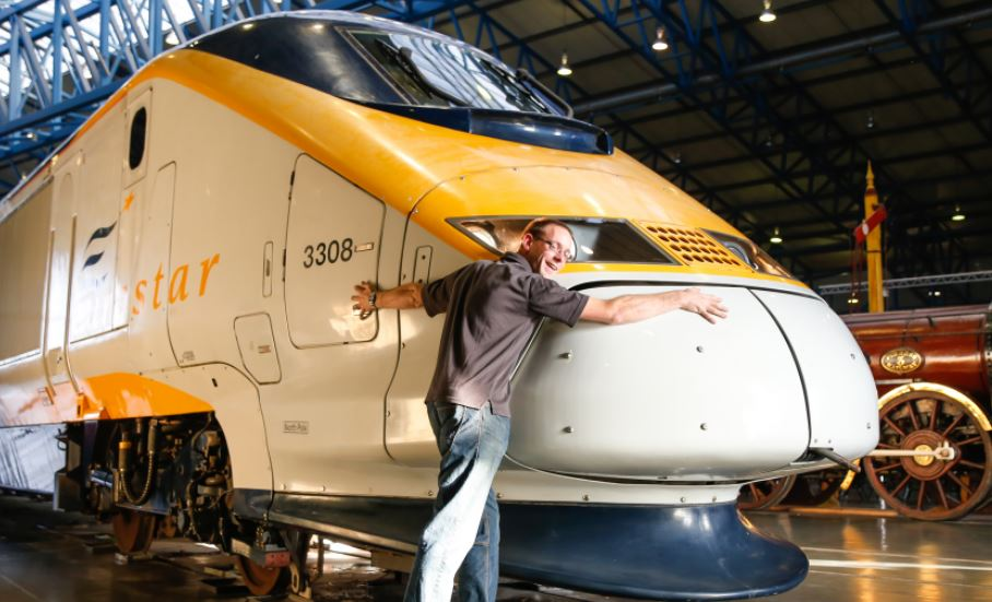 The author, Chris McCandless-Stone, with his beloved Eurostar power car, pictured in Great Hall on 20 October 2015. Chris was responsible for bringing the power cab to the National Railway Museum on behalf of Eurostar.