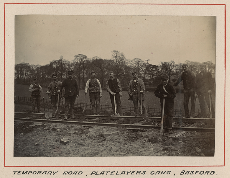Navvies laying a temporary track at Basford