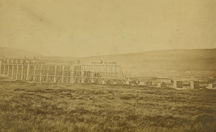 The Ribblehead Viaduct under construction – the settlement buildings can faintly be seen in the background to the right of the picture. National Railway Museum Collection.