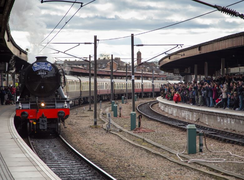 Arriving into York station, only slightly later than schedule due to some over enthusiastic spectators .