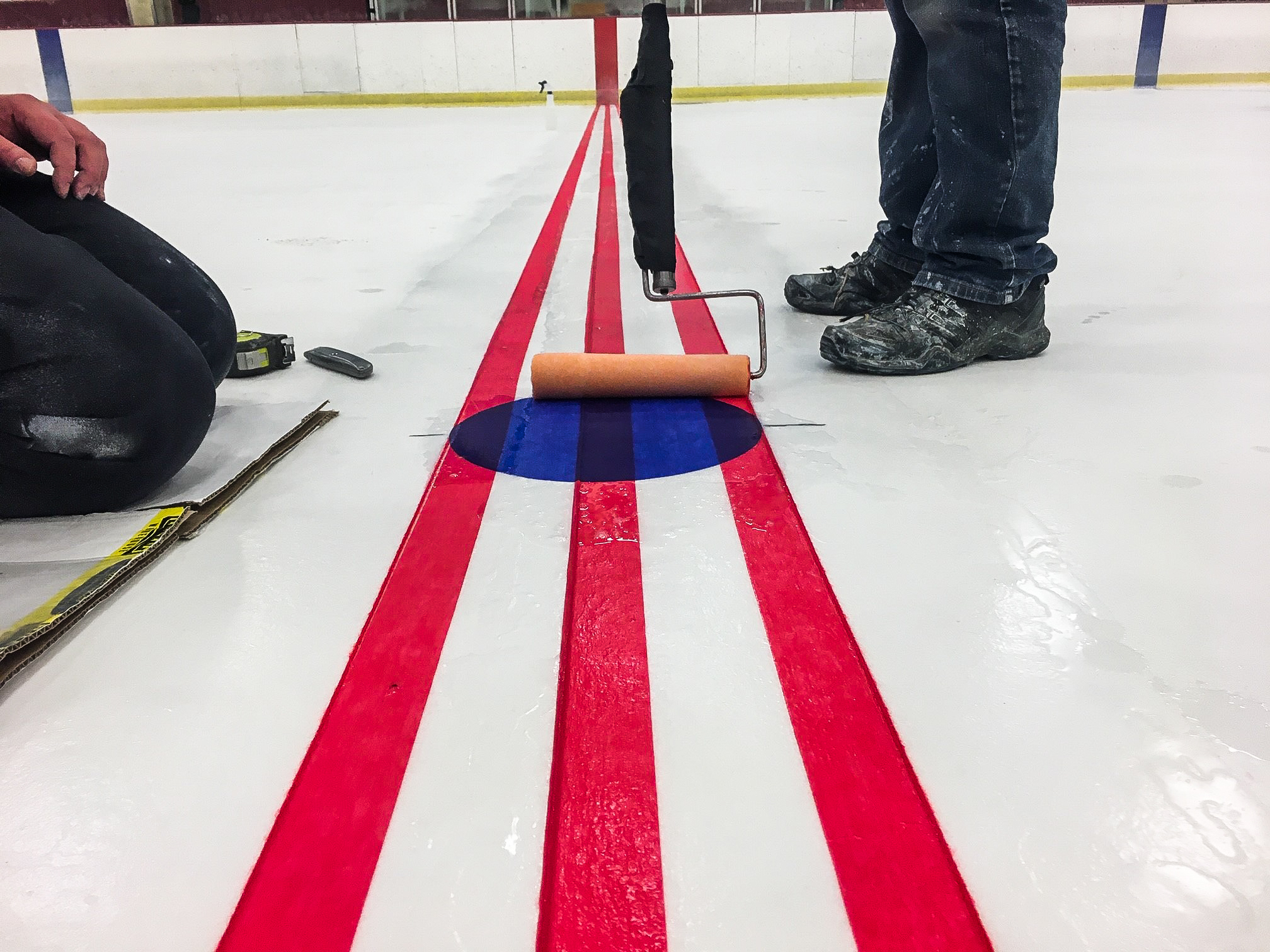 While campus was closed to visitors because of COVID-19, staff conducted facility updates such as repainting the Super Rink ice sheets.