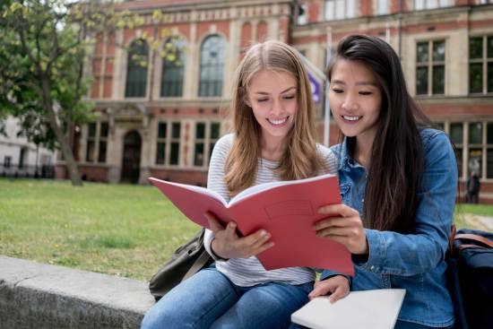 Two female students studying together