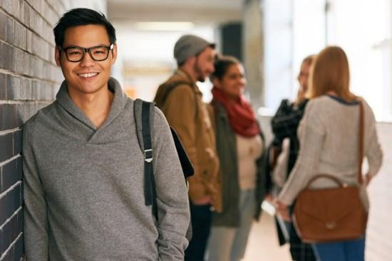 College Student Standing in Hallway