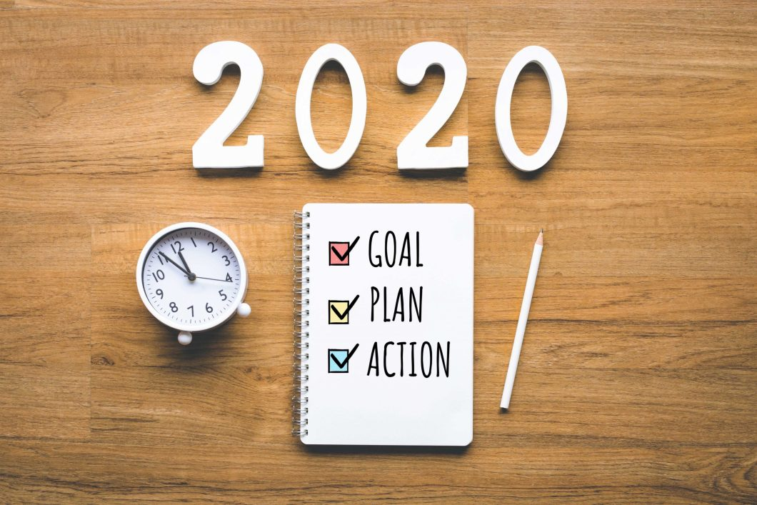 Goal-plan-action notebook on table for 2020