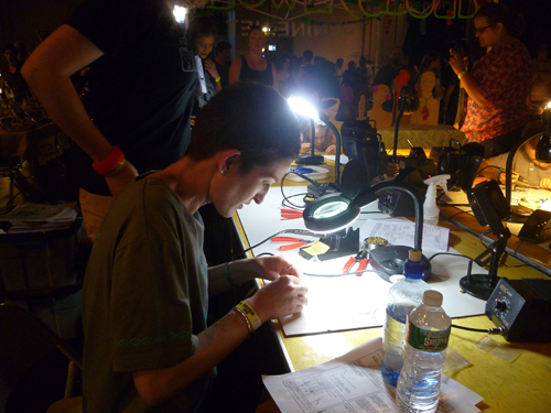 Ruth learning to solder at AS220 Labs' booth in the Rhode Island Mini Maker Faire, hosted by Foo Fest.