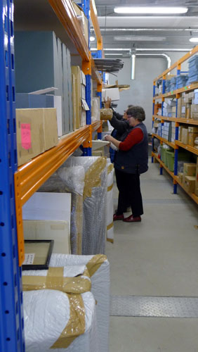 Kaiapoi staff amongt the CCCRC shelves.