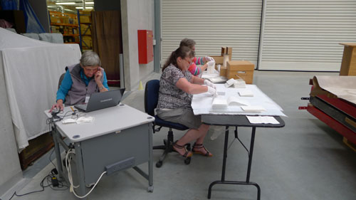 Kaiapoi staff cataloguing their glass plate negatives.