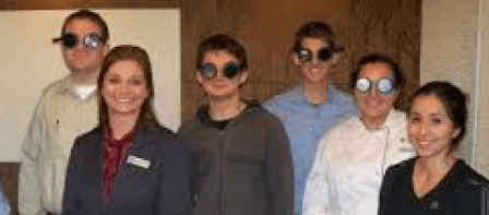 people wearing goggles from the zimmerman low vision simulation kit