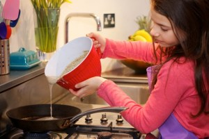 Image of girl making pancakes