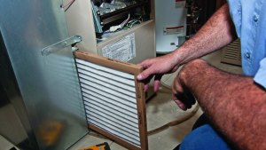 Change your HVAC filter to help keep the air clean in your office and increase air quality