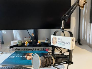 Set up of a boom microphone with pop filter and Ben Franklin's World design