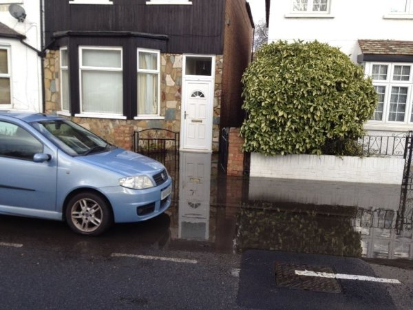 [IMG: Flooded front door]