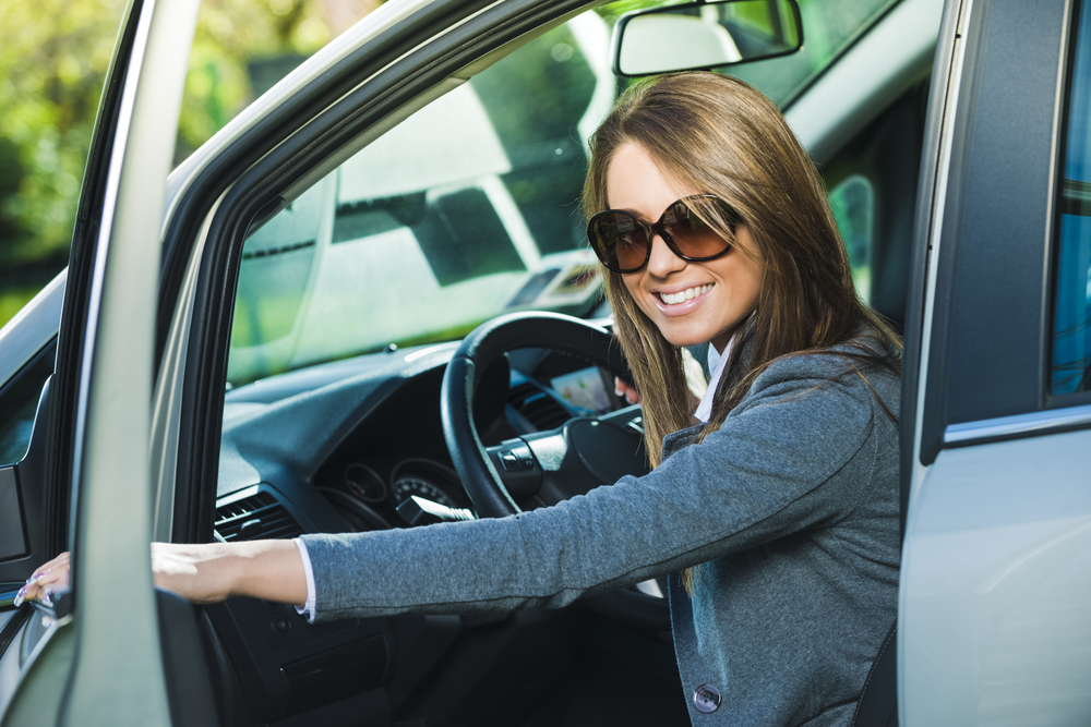 Happy female wearing driving sunglasses